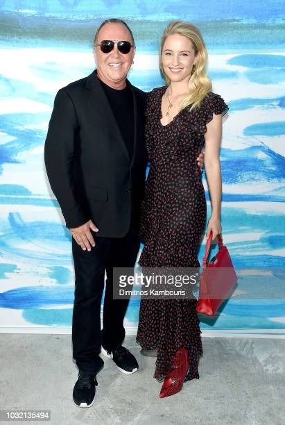Michael Kors and Diana Argon pose backstage during the Michael Kors Collection Spring 2019 Runway Show at Pier 17 on September 12 2018 in New York...