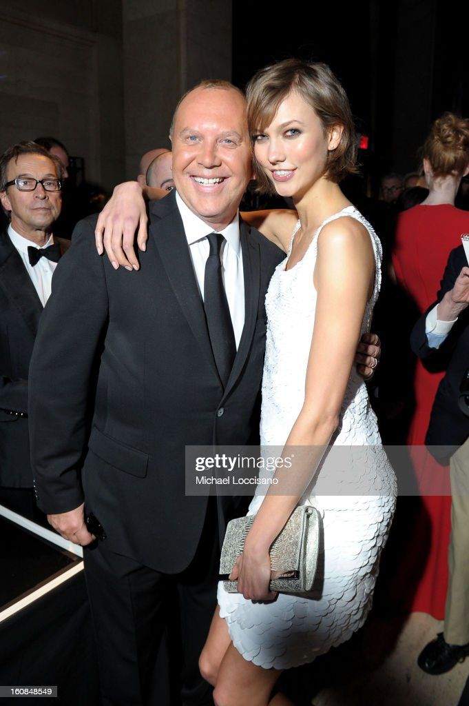 Michael Kors (L) and Karlie Kloss attend the amfAR New York Gala to kick off Fall 2013 Fashion Week at Cipriani Wall Street on February 6, 2013 in New York City.
