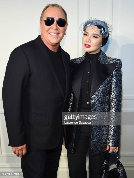 Michael Kors and Neelofa pose backstage during the Michael Kors Collection Spring 2020 Runway Show on September 11 2019 in Brooklyn City