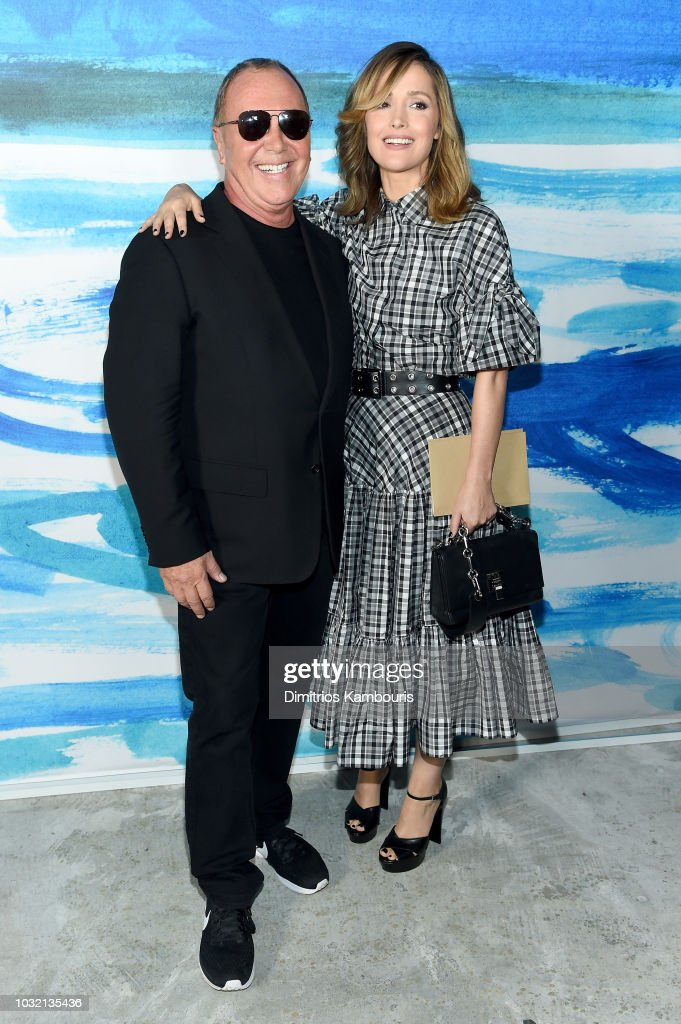 Michael Kors (L) and Rose Byrne pose backstage during the Michael Kors Collection Spring 2019 Runway Show at Pier 17 on September 12, 2018 in New York City.