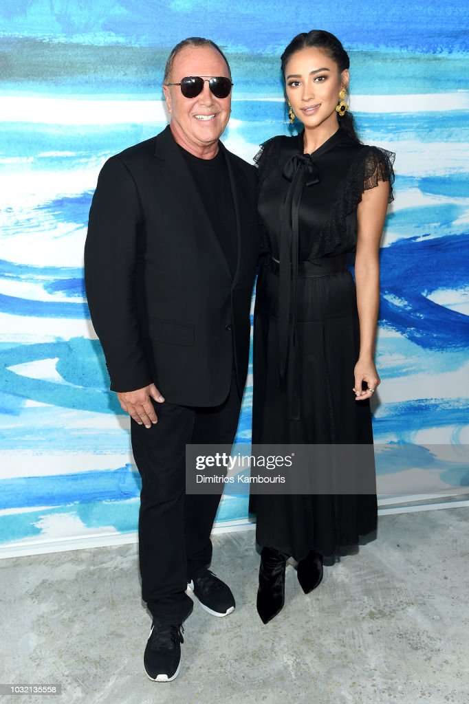 Michael Kors (L) and Shay Mitchell pose backstage during the Michael Kors Collection Spring 2019 Runway Show at Pier 17 on September 12, 2018 in New York City.