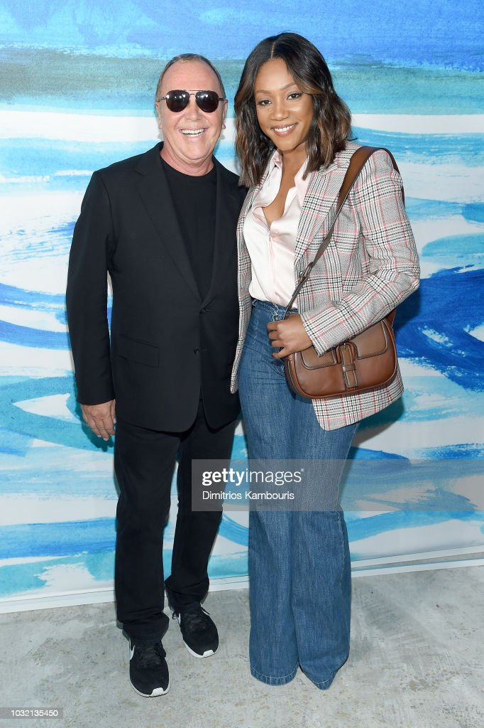 Michael Kors (L) and Tiffany Haddish pose backstage during the Michael Kors Collection Spring 2019 Runway Show at Pier 17 on September 12, 2018 in New York City.