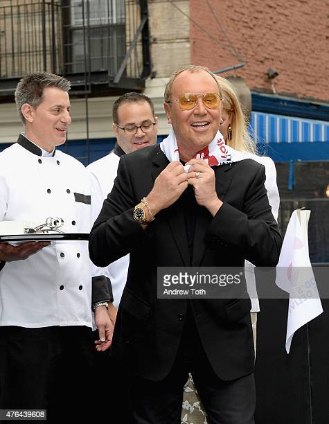 Michael Kors appears onstage during the celebration of God's Love We Deliver returning to Soho with a dedication of the new Michael Kors building on...