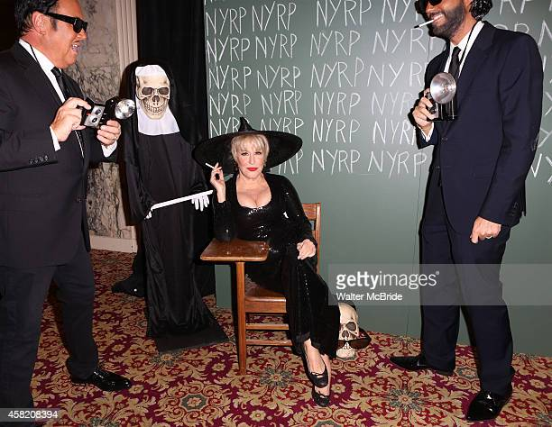 Michael Kors Bette Midler and Lance LePere attend the 19th Annual Hulaween Gala Fellini Hulaweeni at the WaldorfAstoria on October 31 2014 in New...