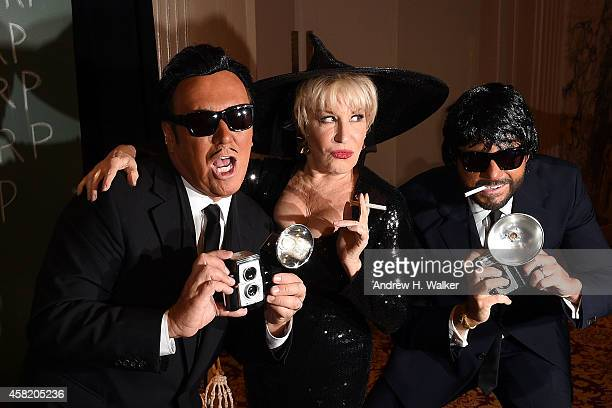 Michael Kors Bette Midler and Lance LePere attend the 2014 Hulaween Gala benefiting New York Restoration Project at The Waldorf=Astoria on October 31...