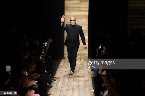 Michael Kors greets the audience from the runway during the Michael Kors FW20 Runway Show on February 12, 2020 in New York City.