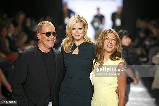 Michael Kors Heidi Klum and Nina Garcia acknowledge the audience at Project Runway Finalists' Spring 2009 at The Promenade in Bryant Park on...