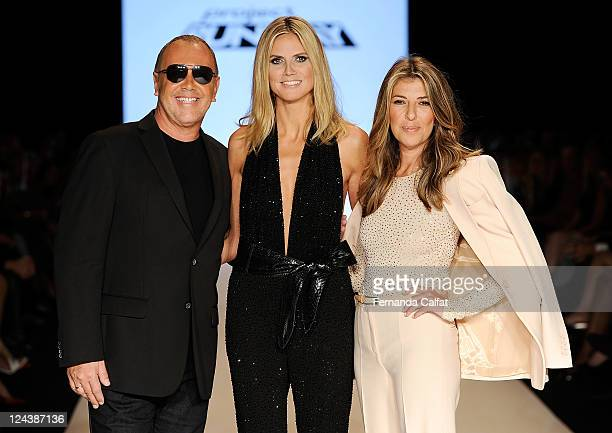 Michael Kors Heidi Klum and Nina Garcia pose on the runway at the Project Runway Spring 2012 fashion show during MercedesBenz Fashion Week at The...