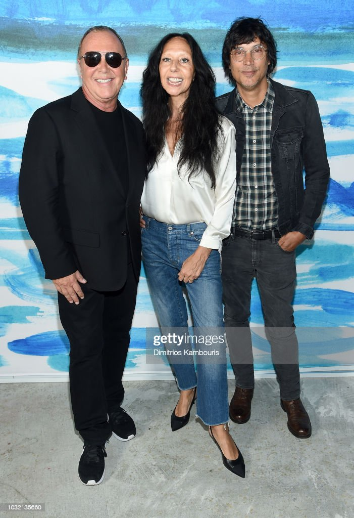 Michael Kors, Inez van Lamsweerde, and Vinoodh Matadin pose backstage during the Michael Kors Collection Spring 2019 Runway Show at Pier 17 on September 12, 2018 in New York City.