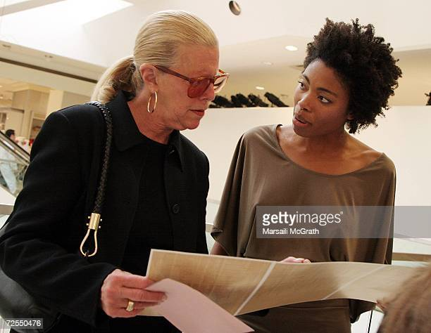 Michael Kors' mother Joan Kors and model Etirsa view the collection pamphlet at the Michael Kors instore appearance and fashion show at Nieman Marcus...