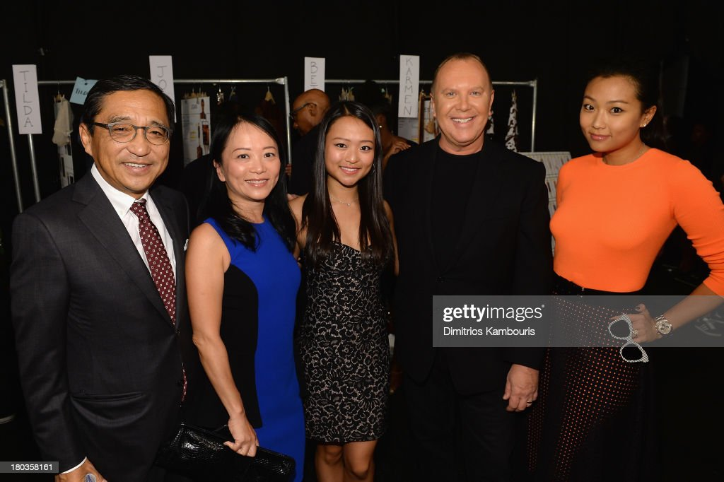 Michael Kors (2nd from R) poses backstage at the Michael Kors fashion show during Mercedes-Benz Fashion Week Spring 2014 at The Theatre at Lincoln Center on September 11, 2013 in New York City.