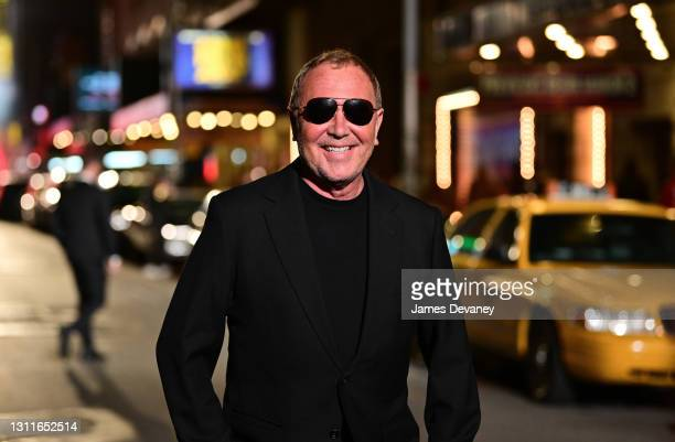 Michael Kors poses on 46th Street during the Michael Kors Fashion Show in Times Square on April 08, 2021 in New York City.