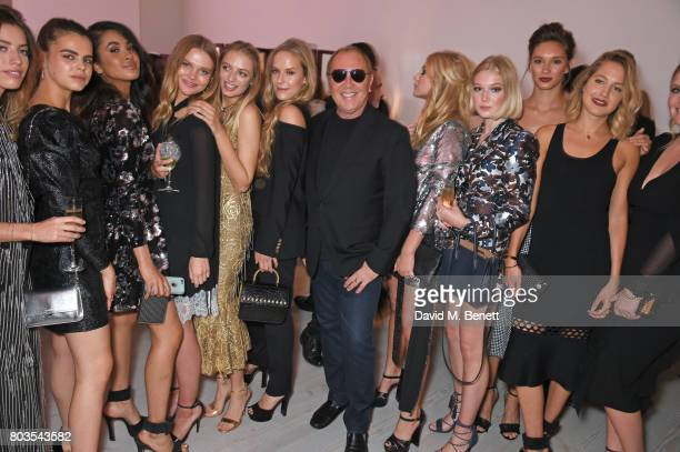 Michael Kors poses with English Roses including Clara McGregor, Aziya Aldridge-Moore, Idina Moncreiffe, Hum Fleming, Lady Lola Crichton-Stuart, Livvy...