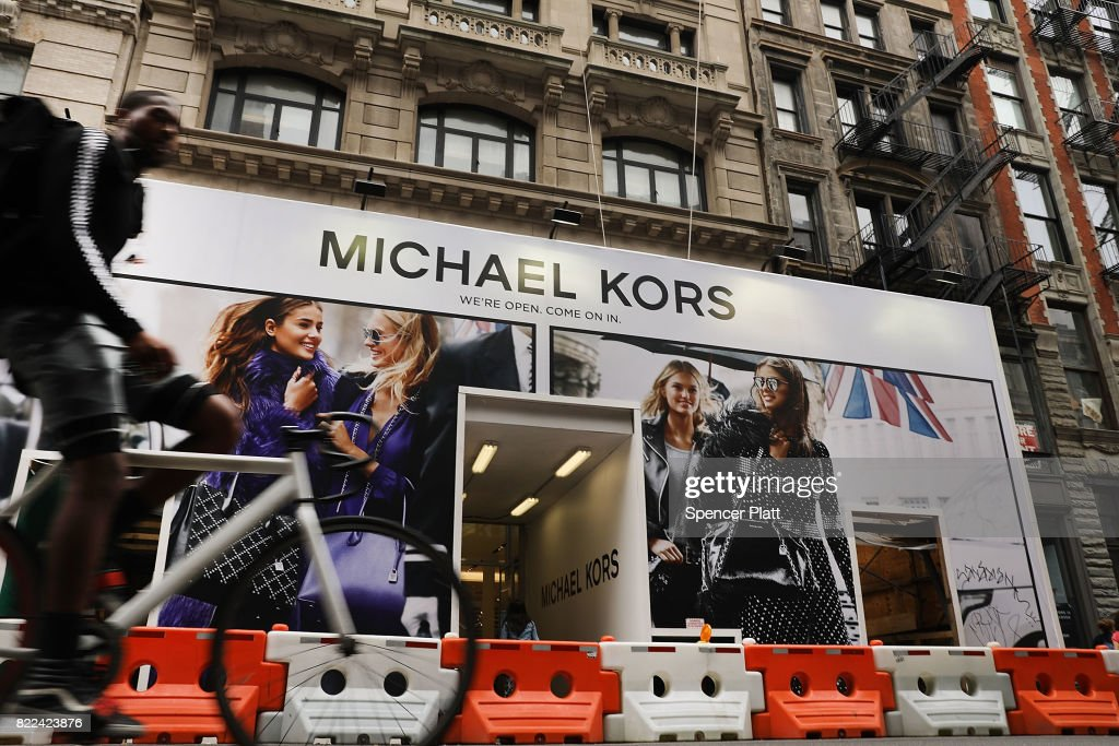 A Michael Kors store stands in lower Manhattan on July 25, 2017 in New York City. Michael Kors Holdings announced on Tuesday that it had agreed to buy the shoe company Jimmy Choo for 896 million pounds, or about $1.2 billion. As retail sales across the country continue to weaken, many companies are starting to search for new sources of growth, especially in more luxury brand markets.