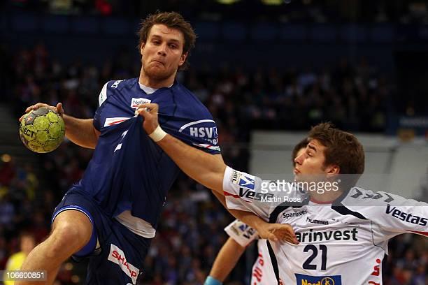 Michael Kraus of Hamburg and Jacob Heinl of Flensburg fight for the ball during the Toyota Handball Bundesliga match between HSV Hamburg and SG...