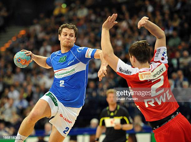Michael Kraus of Hamburg is challenged by Sebastian Bliss of Essen during the DKB Bundesliga handball game between HSV Hamburg and TUSEM Essen at O2...