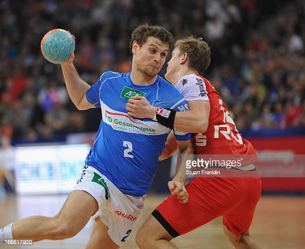 Michael Kraus of Hamburg is challenged byNiclas Pieczkowski of Essen during the DKB Bundesliga handball game between HSV Hamburg and TUSEM Essen at...