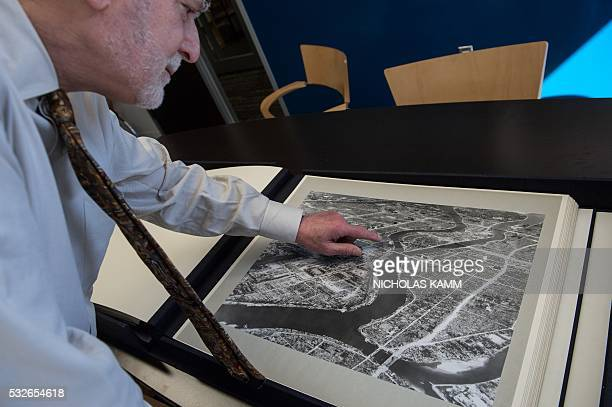 Michael Krepon cofounder of the Stimson Center think tank shows an aerial picture taken by the US military in the days after the first atomic bomb...