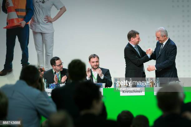 Michael Kretschmer designated prime minister of the German State of Saxony shakes his hand with Stanislaw Tillich CDU prime minister of the German...