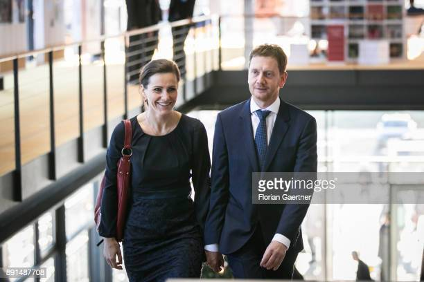 Michael Kretschmer designated prime minister of the German State of Saxony and his partner Annett Hofmann are pictured on December 13 2017 in Dresden...