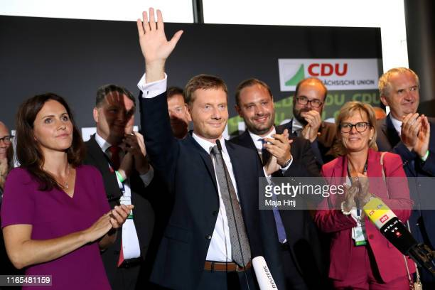 Michael Kretschmer Governor of Saxony and member of the German Christian Democrats waves as he reacts to initial exit poll results in the Saxony...
