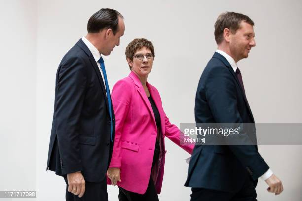 Michael Kretschmer Governor of Saxony Leader of the German Christian Democratic Party Annegret KrampKarrenbauer and Ingo Senftleben candidate of the...