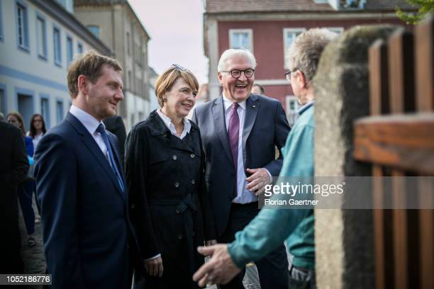 Michael Kretschmer prime minister of the German State of Saxony Elke Buedenbender wife of the German President and German President FrankWalter...
