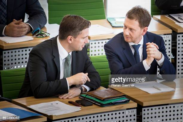 Michael Kretschmer prime minister of the German State of Saxony talks with Martin Dulig deputy prime minister on December 13 2017 in Dresden Germany...