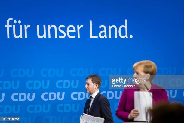 Michael Kretschmer prime minister of the German State of Saxony crosses the stage after the speech of German Chancellor Angela Merkel on February 26...