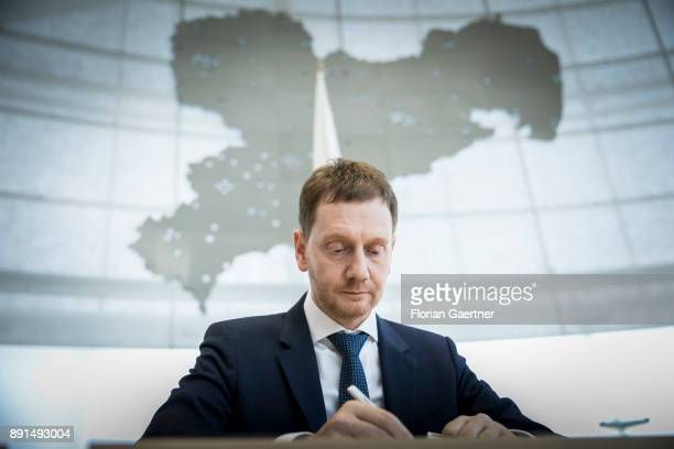 Michael Kretschmer prime minister of the German State of Saxony works at the government bench after his election the the prime minister on December...
