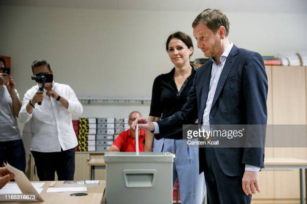 Michael Kretschmer Saxony's State Premier and top candidate of German Christian Democrats and his companion Annett Hofmann cast the ballot for state...