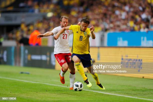 Michael KrohnDehli of Denmark and Albin Ekdal of Sweden competes for the ball during the International Friendly match between Sweden and Denmark at...
