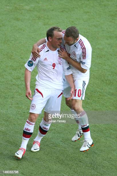 Michael Krohn-Dehli of Denmark celebrates scoring their first goal with Dennis Rommedahl during the UEFA EURO 2012 group B match between Netherlands...