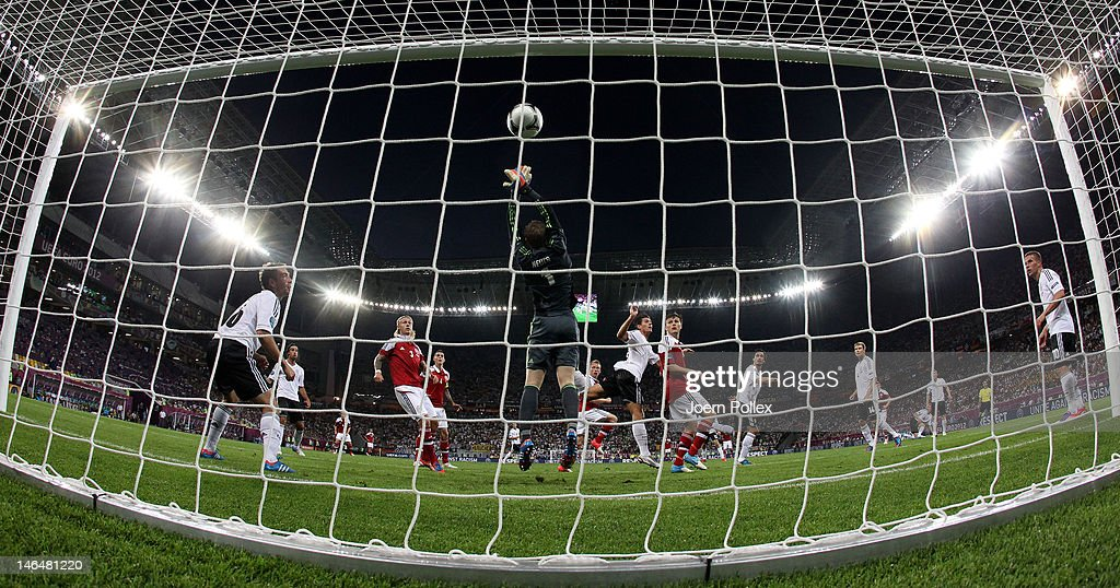 L'VIV, UKRAINE - JUNE 17: Michael Krohn-Dehli of Denmark scores their first goal past Manuel Neuer of Germany during the UEFA EURO 2012 group B match between Denmark and Germany at Arena Lviv on June 17, 2012 in L'viv, Ukraine.