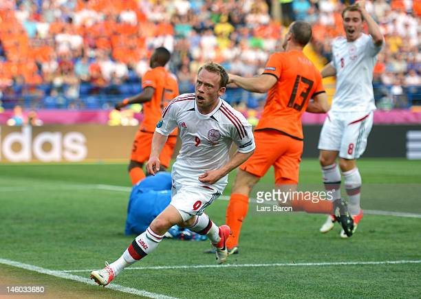 Michael Krohn-Dehli of Denmark turns to celebrate scoring their first goal during the UEFA EURO 2012 group B match between Netherlands and Denmark at...