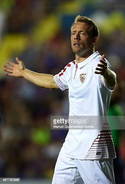 Michael KrohnDehli of Sevilla reacts during the La Liga match between Levante UD and Sevilla FC at Ciutat de Valencia Stadium on September 11 2015 in...