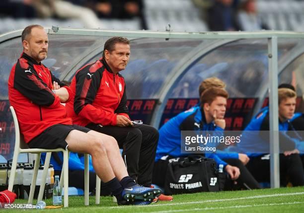 Michael Kryger assistant coach of Hobro IK and Thomas Thomasberg head coach of Hobro IK on the bench duringthe Danish Alka Superliga match between...