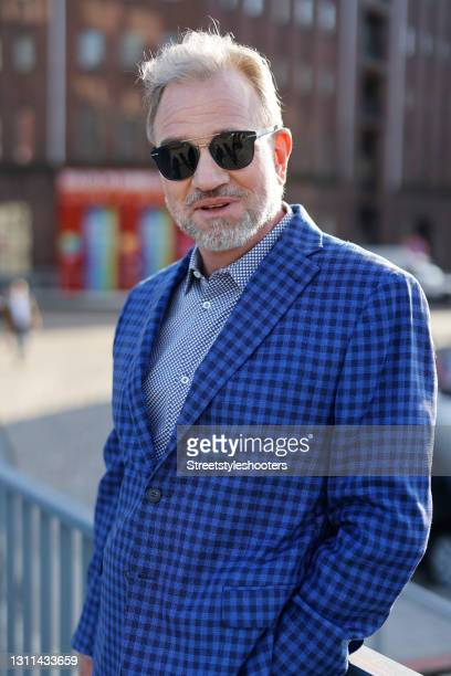Michael Kubenz, husband of best ager model Petra van Bremen, wearing sunglasses by Dior Homme, a dark blue and black checkered jacket by Cerruti, a...