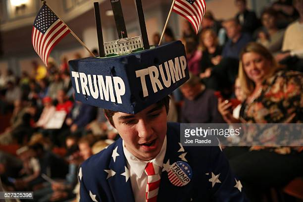 Michael Kuzma shows his support for Republican presidential candidate Donald Trump during his campaign stop at the Palladium at the Center for the...