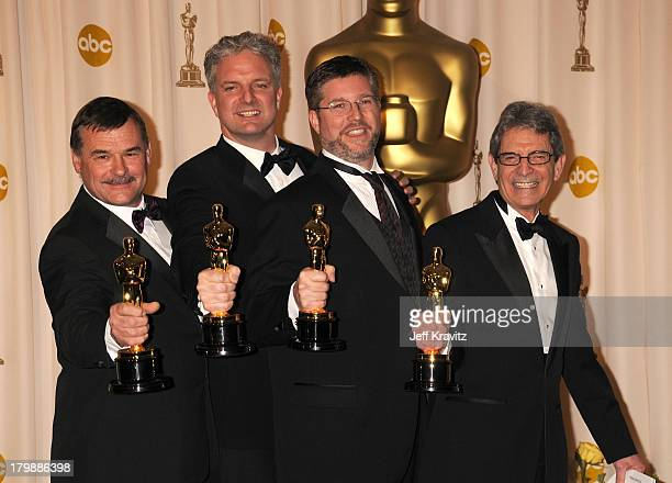 Michael L Fink Bill Westenhofer Ben Morris and Trevor Wood poses in the press room during the 80th Annual Academy Awards at the Kodak Theatre on...