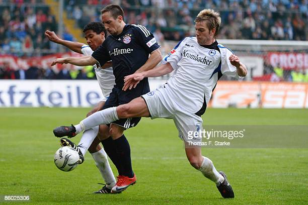 Michael Lamey and Thorben Marx of Bielefeld tackle for the ball with Franck Ribery of Muenchen during the Bundesliga match between Arminia Bielefeld...