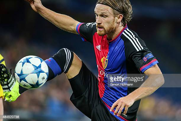 Michael Lang of Basel controls the ball during the UEFA Champions League qualifying round play off first leg match between FC Basel and Maccabi Tel...