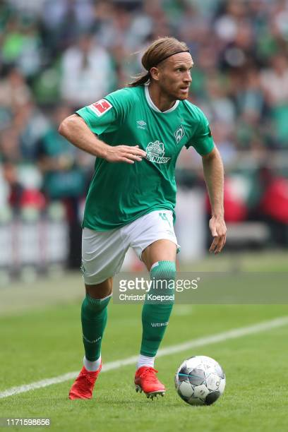 Michael Lang of Bremen runs with the ball during the Bundesliga match between SV Werder Bremen and FC Augsburg at Wohninvest Weserstadion on...