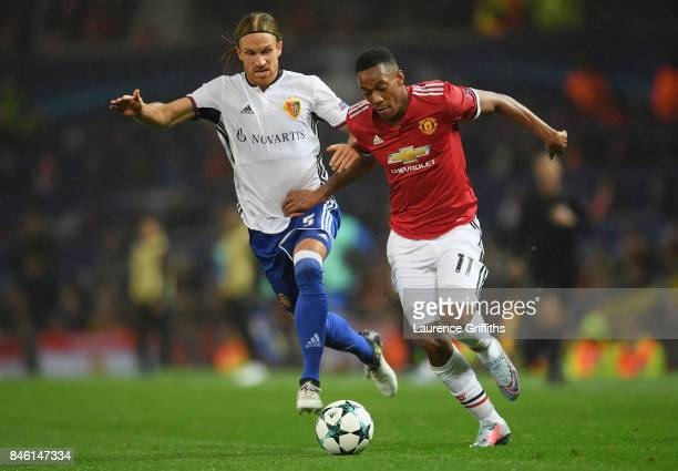 Michael Lang of FC Basel and Anthony Martial of Manchester United battle for possession during the UEFA Champions League Group A match between...