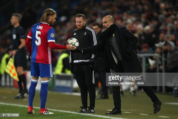 Michael Lang of FC Basel and Pep Guardiola the head coach / manager of Manchester City during the UEFA Champions League Round of 16 First Leg match...