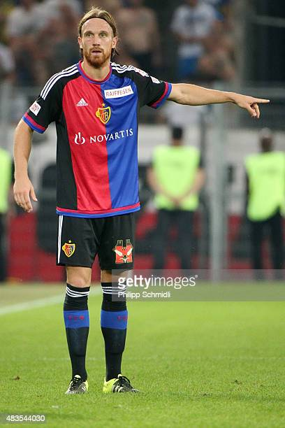 Michael Lang of FC Basel directs his teammates during the UEFA Champions League third qualifying round 2nd leg match between FC Basel 1893 and KKS...