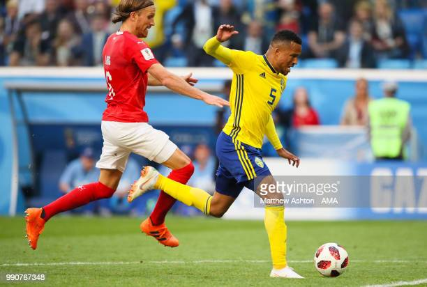 Michael Lang of Switzerland fouls Martin Olsson of Sweden and is subsequently sent off during the 2018 FIFA World Cup Russia Round of 16 match...