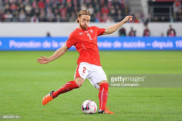 Michael Lang of Switzerland in action during the UEFA EURO 2016 qualifier between Switzerland and San Marino at AFG Arena on October 9 2015 in St...