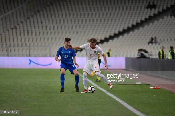 STADIUM ATHENS ATTIKI GREECE Michael Lang of Switzerland tries to pass the ball from Panagiotis Retsos of Greece Switzerland won against Greece with...