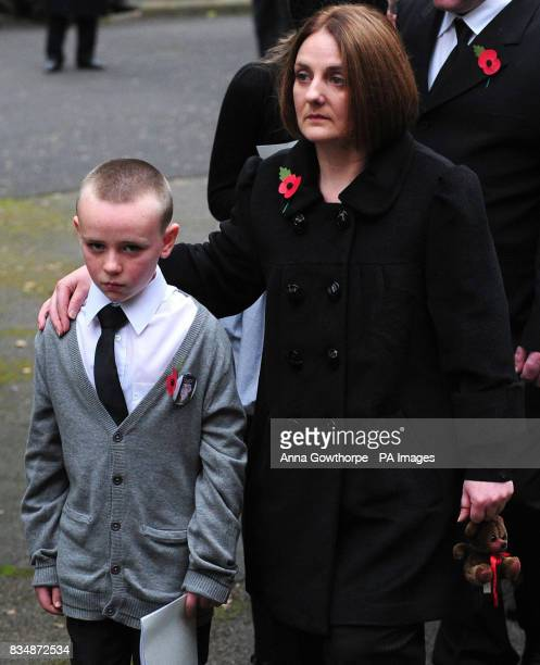 Michael Lappin and Toni Lappin brother and mother of murdered Joseph Lappin lead mourners from church after the funeral service for Joseph at St...